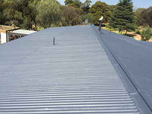 Zinc roof repaired and painted.